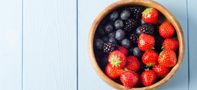 Bowl of fresh strawberries blueberries blackberries
